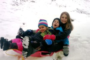 kids in sled